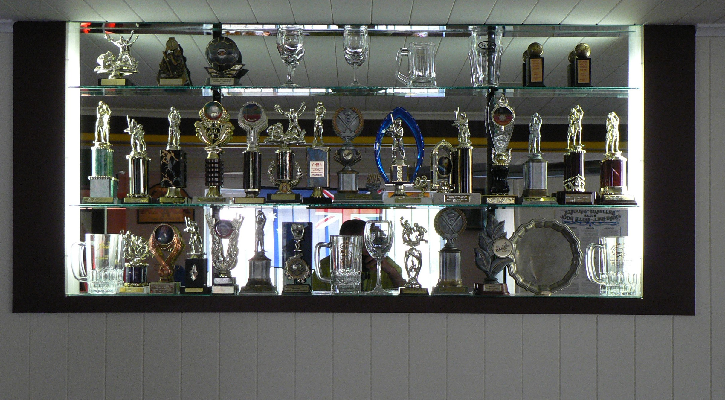 Before And After Photos Of A Trophy Display Unit Recessed Into The Wall